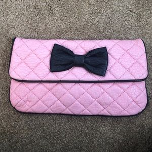 Pink faux leather clutch
